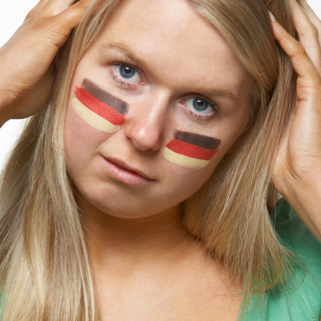 """""""Disappointed Young Female Sports Fan With German Flag Painted On Face"""" stock image"""