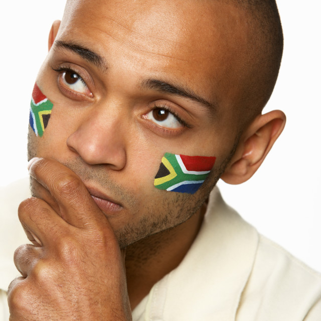 """""""Disappointed Young Male Sports Fan With South African Flag Painted On Face"""" stock image"""