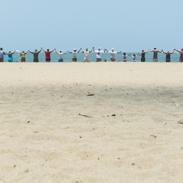 """Section of a line of people on a beach"" stock image"