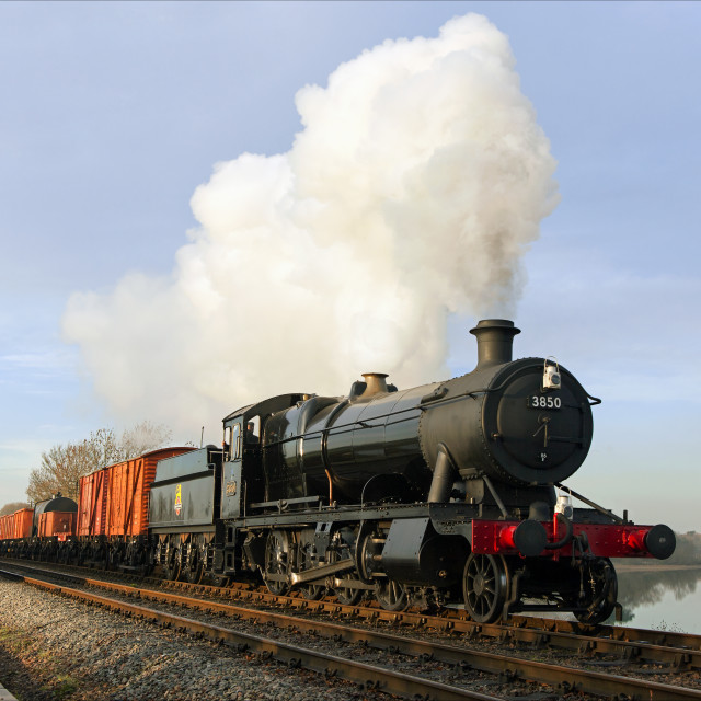 """Goods train crossing the water"" stock image"