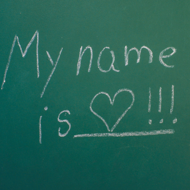 """My name is love, written in white chalk on green chalkboard"" stock image"