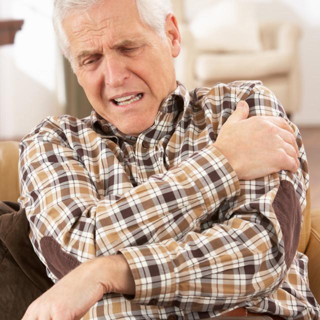 """Senior Man Suffering Cardiac Arrest At Home"" stock image"