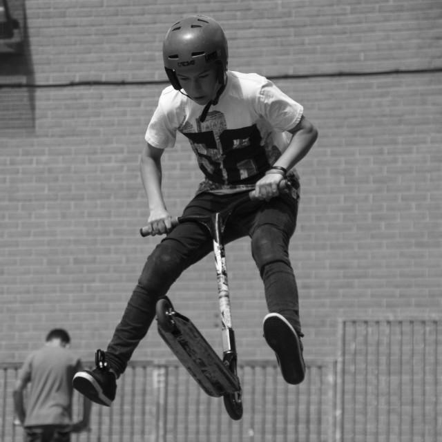 """Scooter stunt"" stock image"