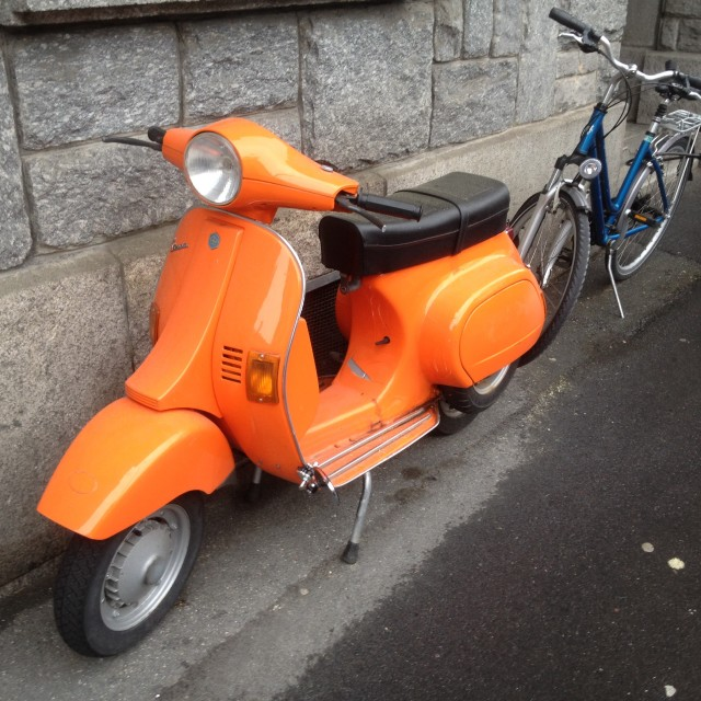 """Orange Vespa"" stock image"