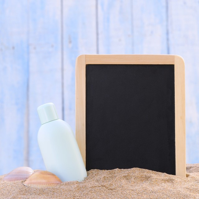 """Sunscreen and blackboard."" stock image"