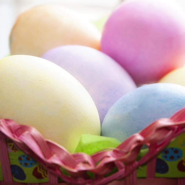 """Colored Eggs in a Basket"" stock image"