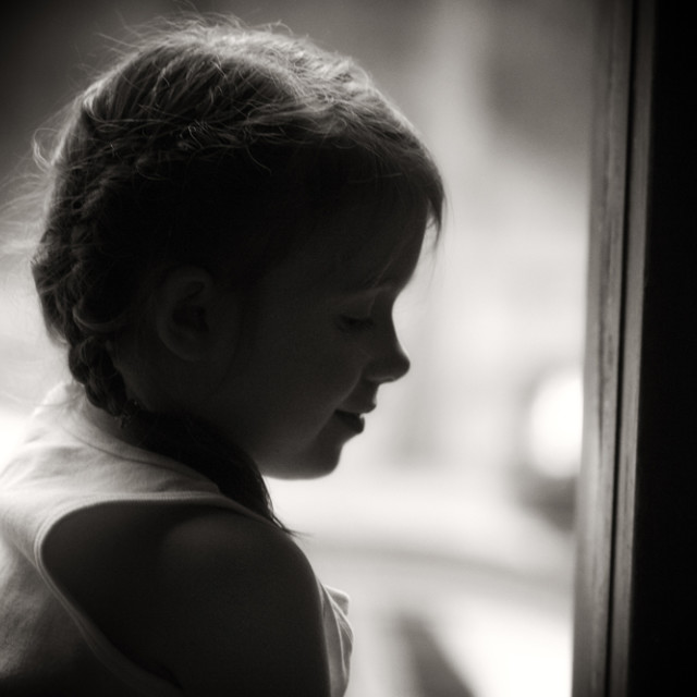 """Girl in Window"" stock image"