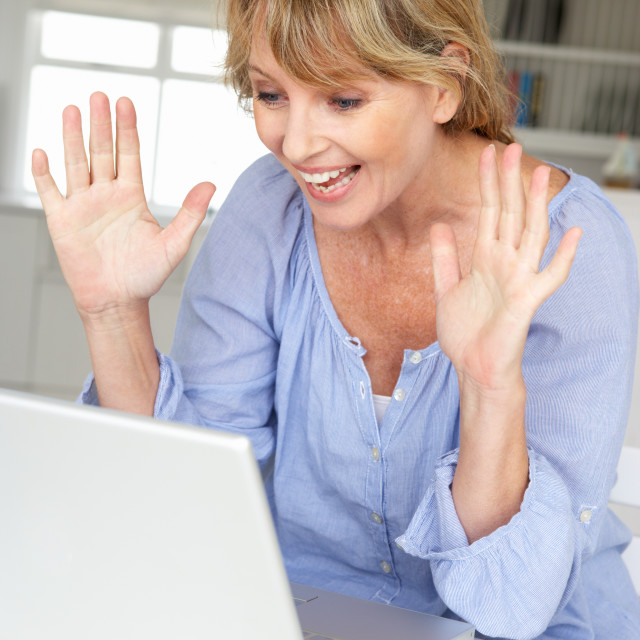 """Mid age woman using laptop"" stock image"