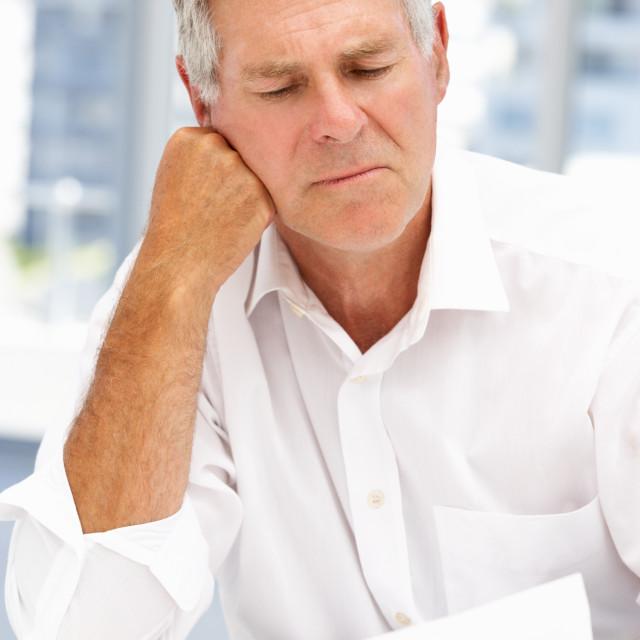 """Unhappy senior businessman"" stock image"