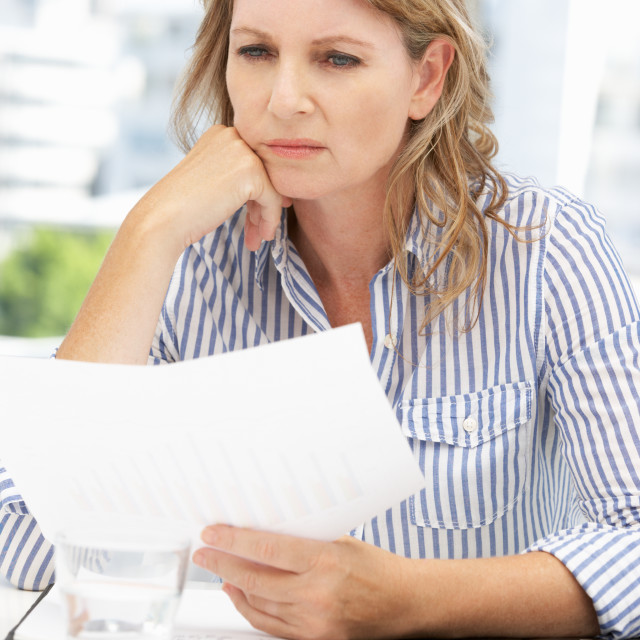 """Worried businesswoman"" stock image"