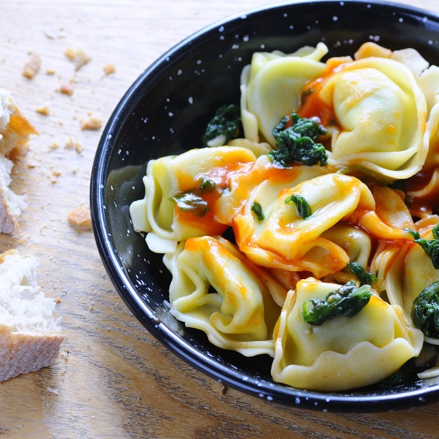 """""""Tortellini with spinach."""" stock image"""