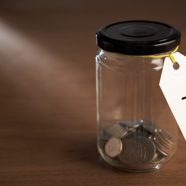 """""""Coins in a jam jar"""" stock image"""