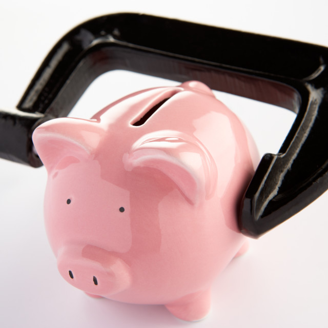 """""""Piggybank in a vice"""" stock image"""
