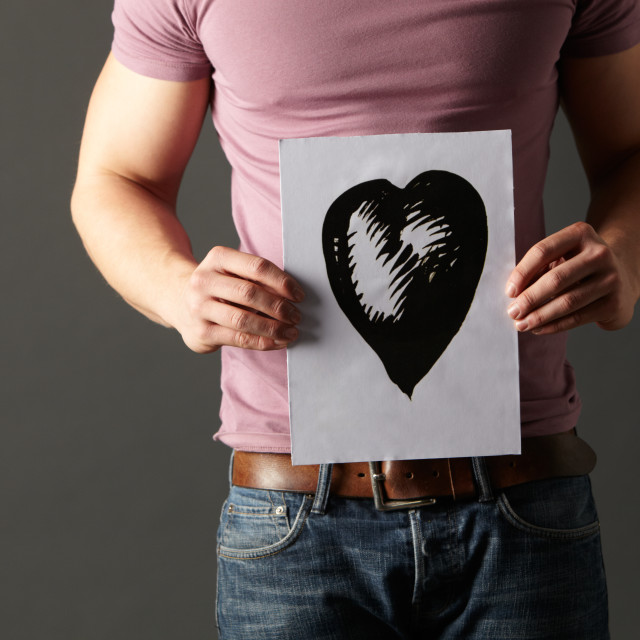 """""""Man holding ink drawing of heart"""" stock image"""