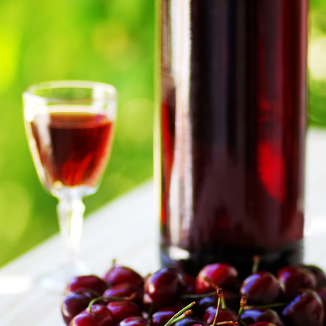 """Cherry fruits and bottle of liqueur"" stock image"