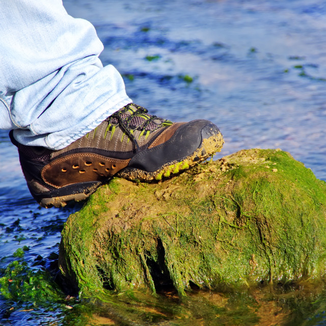 """""""Boot on a rock in water of river"""" stock image"""