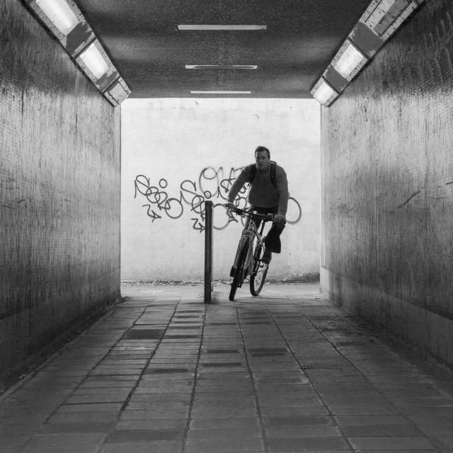 """Underground cyclist"" stock image"