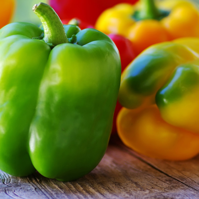 """yellow, red, green peppers on table"" stock image"