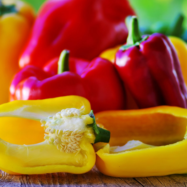 """red, yellow and green pepper on table"" stock image"