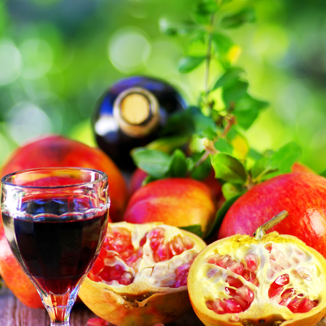 """""""Glass of Red wine and pomegranates"""" stock image"""