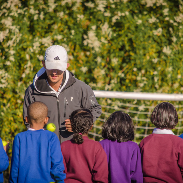 """Tennis Coach & Kids"" stock image"