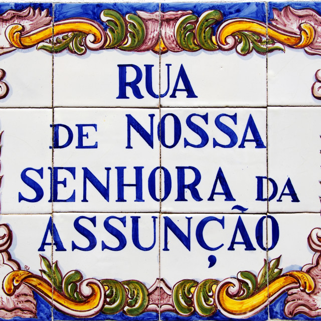 """Portuguese tile plaque on street"" stock image"