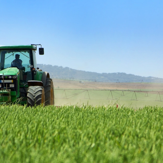 """""""Green tractor working ."""" stock image"""