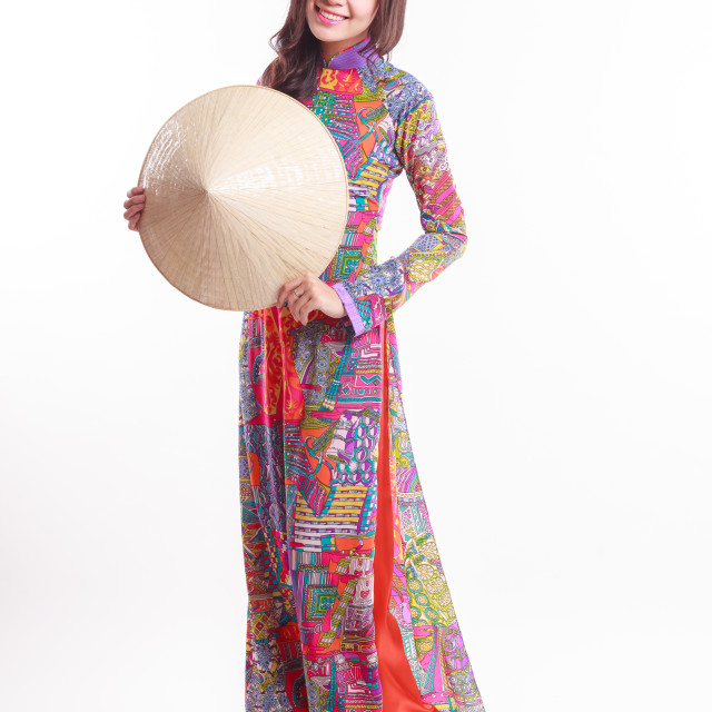 """""""Beautiful Vietnamese woman with tradition ao dai with modern design and palm-leaf conical hat ( non la ) on white background"""" stock image"""