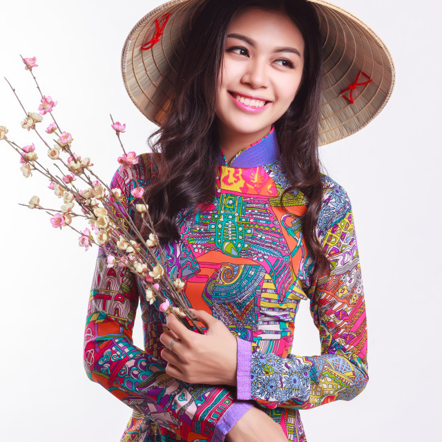 """Beautiful Vietnamese woman with tradition ao dai with modern design and palm-leaf conical hat ( non la ) on white background"" stock image"