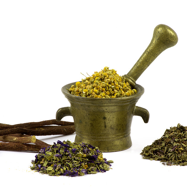"""Old mortar with camomile and herbs"" stock image"