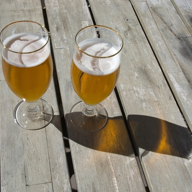"""Two beers on rustic wooden table"" stock image"