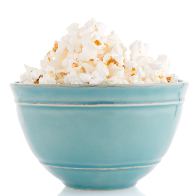 """Popcorn in a blue bowl"" stock image"