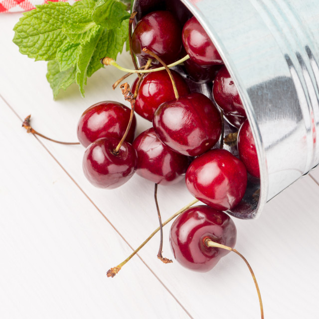 """Cherries in small metal bucket"" stock image"
