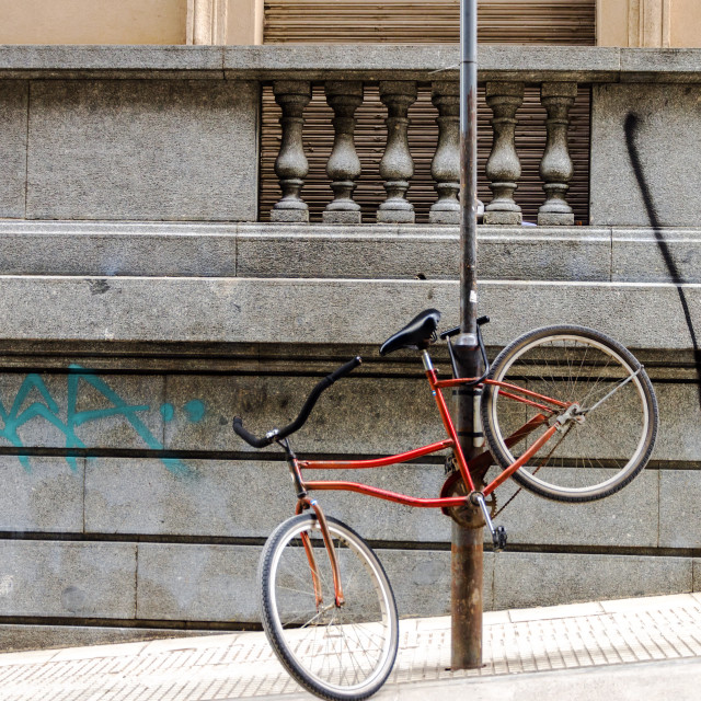 """Bicycle Chained to a Post"" stock image"