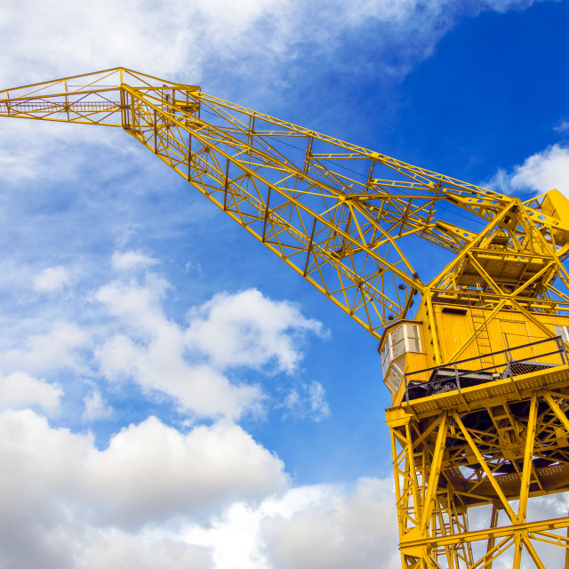 """Yellow Crane and Sky"" stock image"