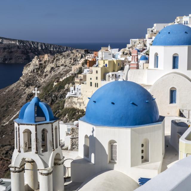 """Blue and white church of Oia village, Santorini"" stock image"