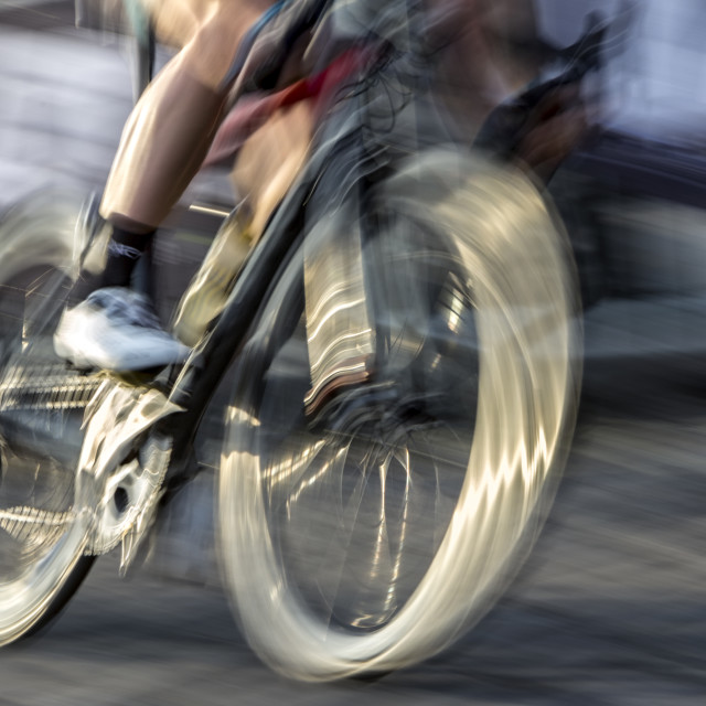 """""""A fast-moving bike"""" stock image"""