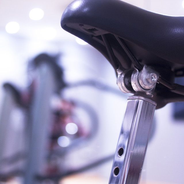 """""""Spinning class exercise bike in gym health club"""" stock image"""