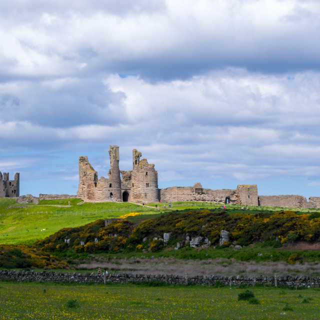 """Dunstanburgh Castle, Northumbria"" stock image"