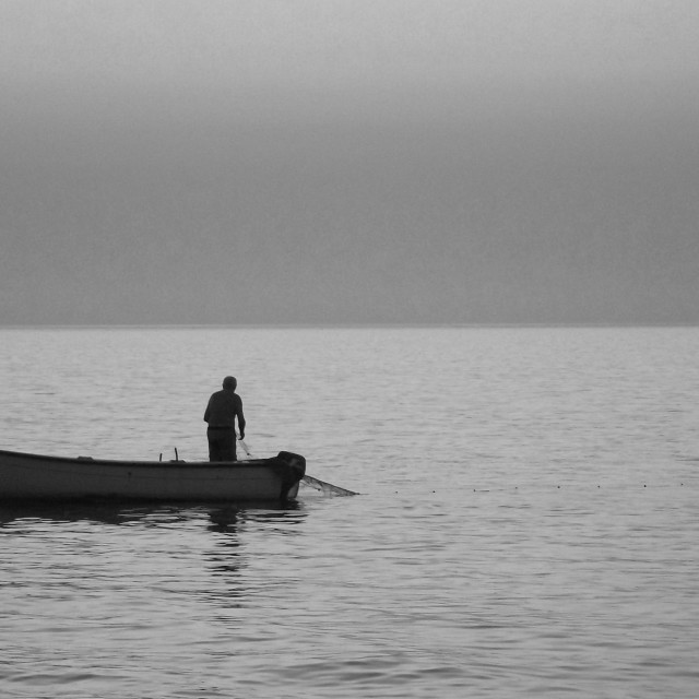 """Lone fisherman"" stock image"