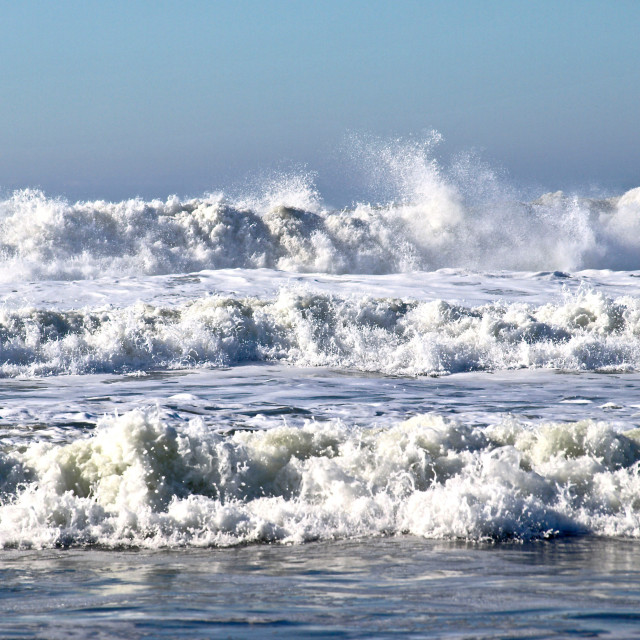 """Waves hit the beach"" stock image"