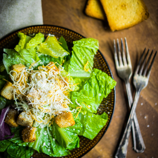 """Caesar salad on rustic background"" stock image"