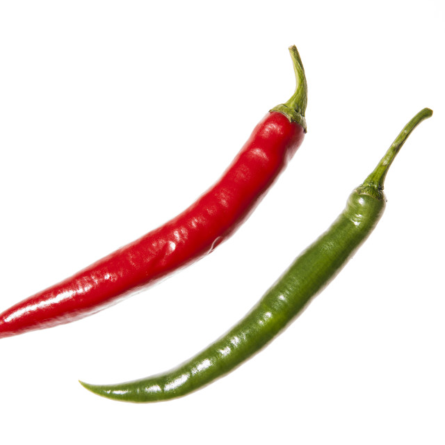 """""""Two long chilli peppers arranged diagonally"""" stock image"""