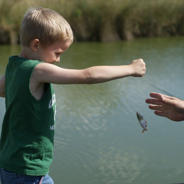 """""""Dad, I caught a big one!"""" stock image"""