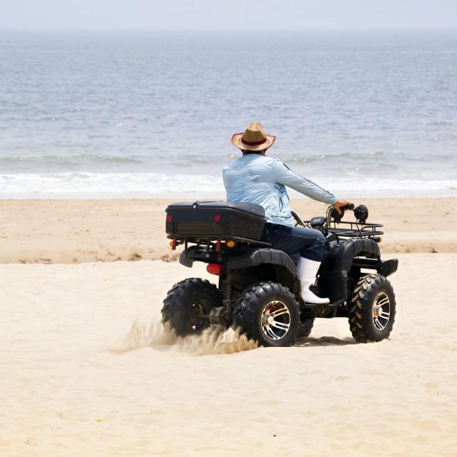 """Quad Biking on the Beach"" stock image"