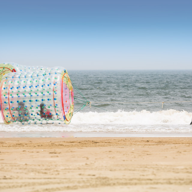 """""""Cylindrical Zorbs in the Ocean"""" stock image"""