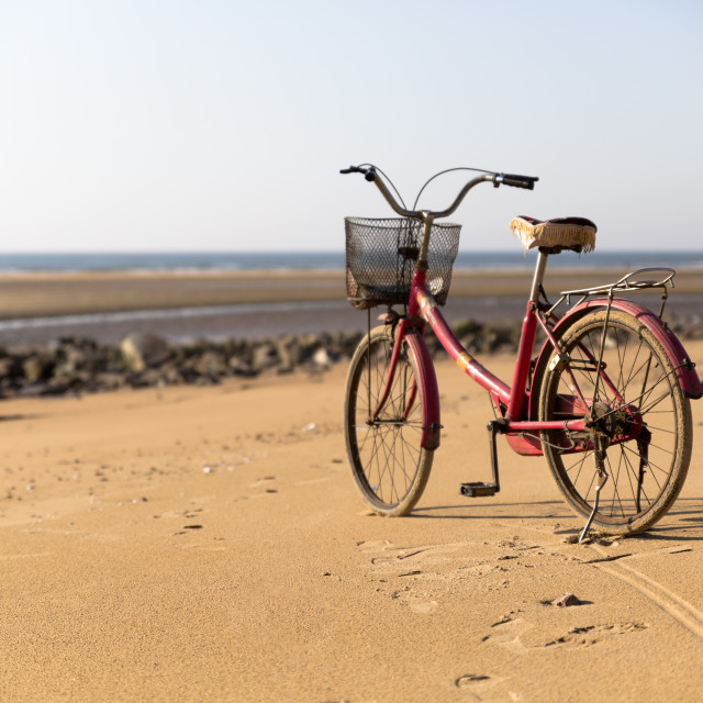 """Lone Old Bicycle on the Beach"" stock image"
