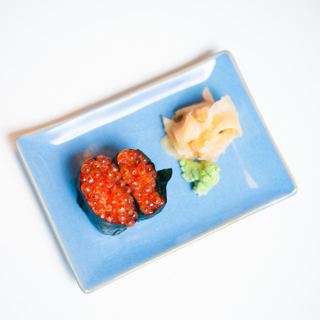 """Gunkan, sushi on blue plate with ginger and wasabi"" stock image"
