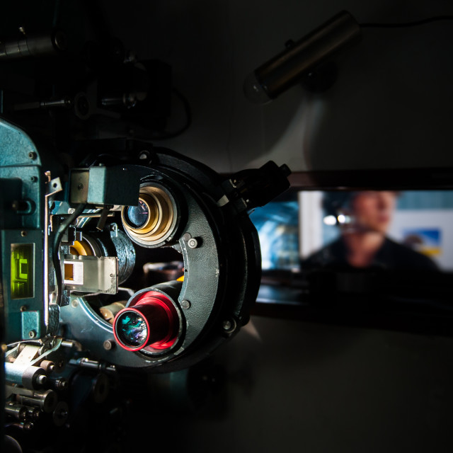 """""""35 mm movie cinema projector machine with out of focus cinema screen"""" stock image"""