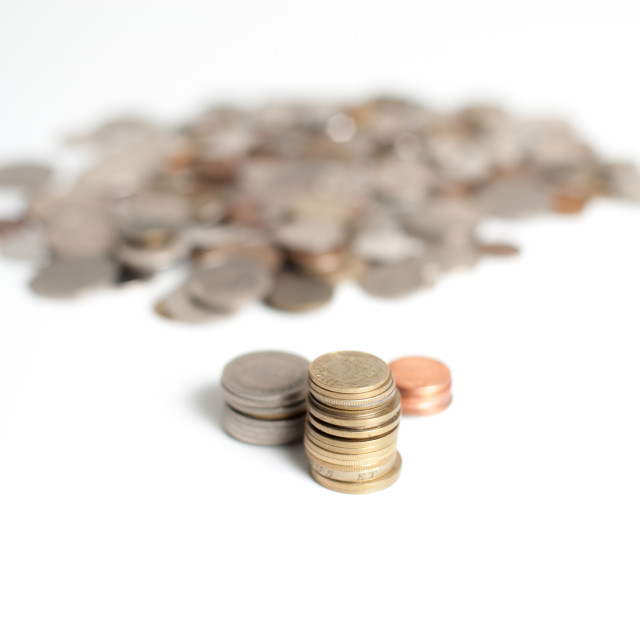 """""""Gold, silver, and bronze piles of coins"""" stock image"""